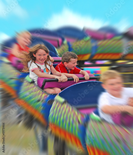 Young kids having fun on rollercoaster
