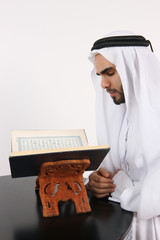 Muslim Man Reading The Holy Quran In The Holy Month Of Ramadan