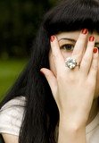 pretty brunet girl covering her face, looking through fingers poster