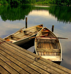 Two old rowing boats on a lake