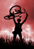 Silhouette of a biker holding his bicycle, red tint poster