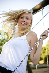 blond girl swinging