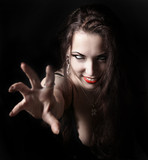 sexy vampire-girl on black background poster
