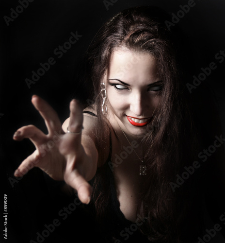 sexy vampire-girl on black background
