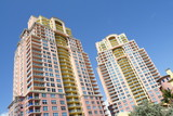 Modern condominiums on a blue sky poster