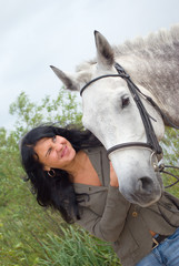 beautiful girl and horse.surprised girl