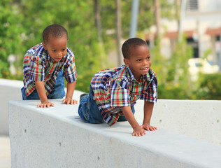 Kids crawling on a ledge