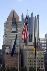 American Flags Near City Buildings