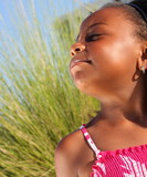 Young girl breathing in the wrm summer air poster