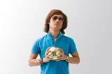 Sporty Asian guy in blue t-shirt holding golden soccer ball poster