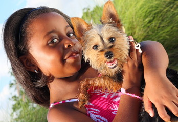 Young child with a cute Yorkie