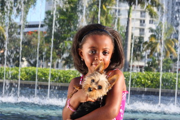 Young child with her puppy