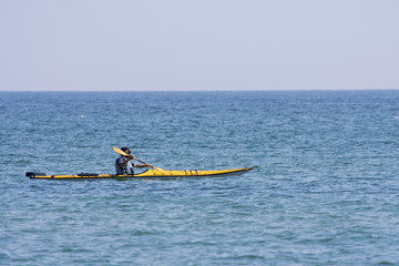 Yellow sea kayak being paddled across a Great Lake