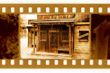 old 35mm frame photo with vintage sheriff house poster