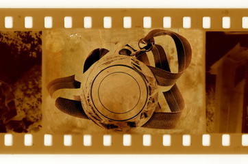 old 35mm frame photo with medal and ribbon