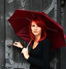 beautiful girl under red umbrella nier the old door