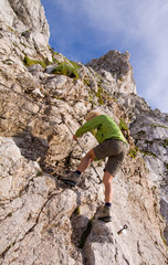 female climbing ferrata in julian alps, slovenia