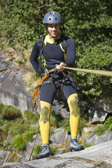 Men prepering for descending waterfall in rappel