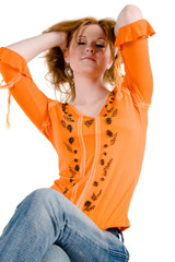 A young redhead girl strikes a glamorous pose