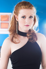 A young woman looks glamorous in a black evening dress