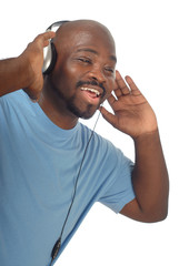 Happy young man laughing while listening to music