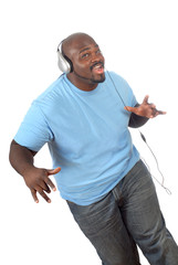 Cool young man dancing and partying with headphones on