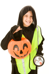 Adorable little boy in his Halloween costume & safety gear