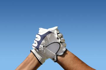 Handschlag mit Golfhandschuhen