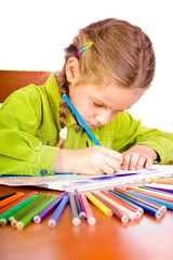Sitting young girl with crayons