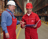 senior worker and engineer in uniforms in warehouse poster