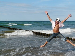 Man jumping and having fun at the beach