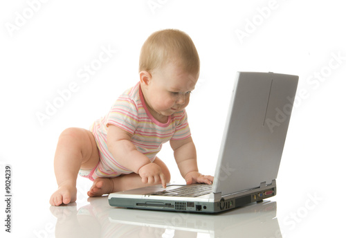 Small baby with laptop #13 isolated on white