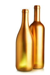 Two gold wine bottles isolated over white background