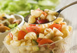 fresh pasta salad with spoon close up shoot