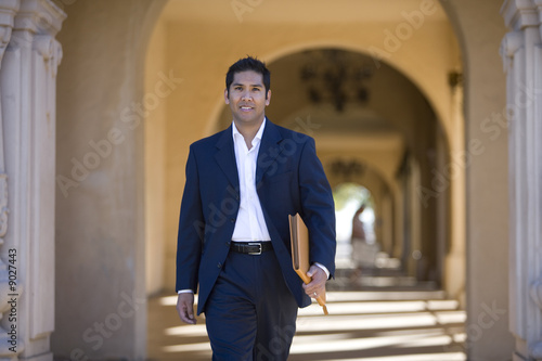 Businessman walking through archway
