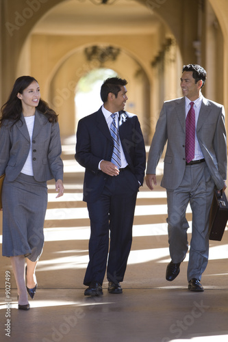 Businesspeople walking through archway