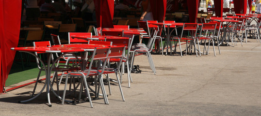 Cafe with metallic chairs and tables in the street