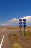 Highway directional signage on a remote stretch of interstate poster