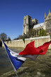 France, Paris, Notre Dame with French flag, low angle view