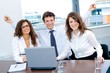 Happy successful business people on meeting smiling