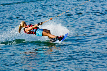 young woman skiing on lake, summer day