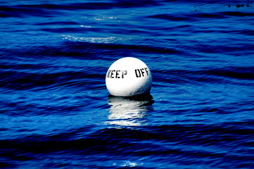 KEEP OFF Buoy white buoy afloat  deep blue sea of Catalina