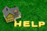 House with the word help on grass. mortgage crisis poster