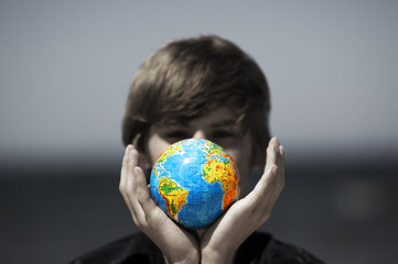 Earth globe in hands protected. Earth protection concept