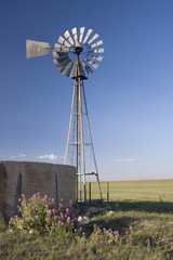 windmill, water pump and concrete tank in shortgrass prairie