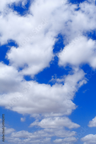 poster of blue sky with white fluffy clouds