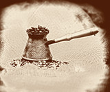 Vintage image background with old-style cezve with coffee beans