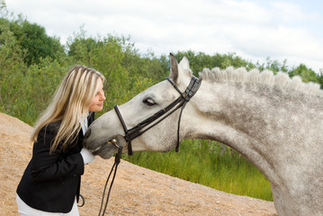 girl with horse.Friendship of an animal and the person
