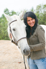 the romantic girl and horse.Contact with nature