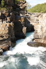 Flowing river through canyon, Abisko National Park in Sweden